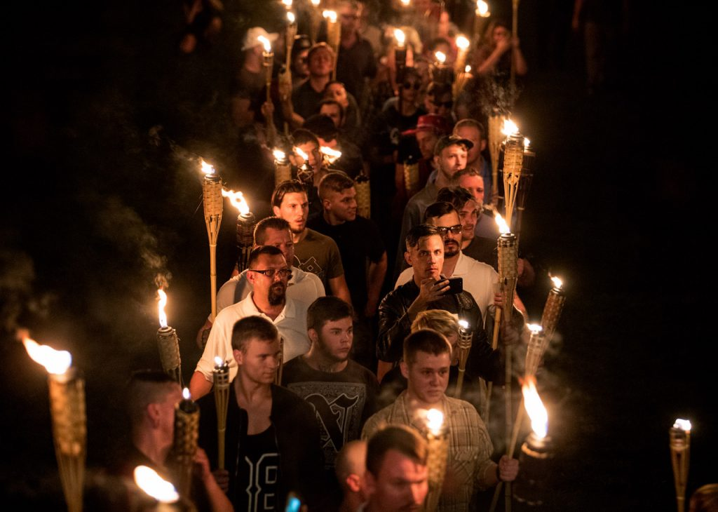 "CHARLOTTESVILLE,VA-AUG11: Chanting ""White lives matter!"" ""You will not replace us!"" and ""Jews will not replace us!"" several hundred white nationalists and white supremacists carrying torches marched in a parade through the University of Virginia campus last night. Beginning a little after 9:30 p.m., the march lasted 15 to 20 minutes before ending in skirmishing when the marchers were met by a small group of counterprotesters at the base of a statue of Thomas Jefferson, the university's founder. (Photo by Evelyn Hockstein/For The Washington Post)"