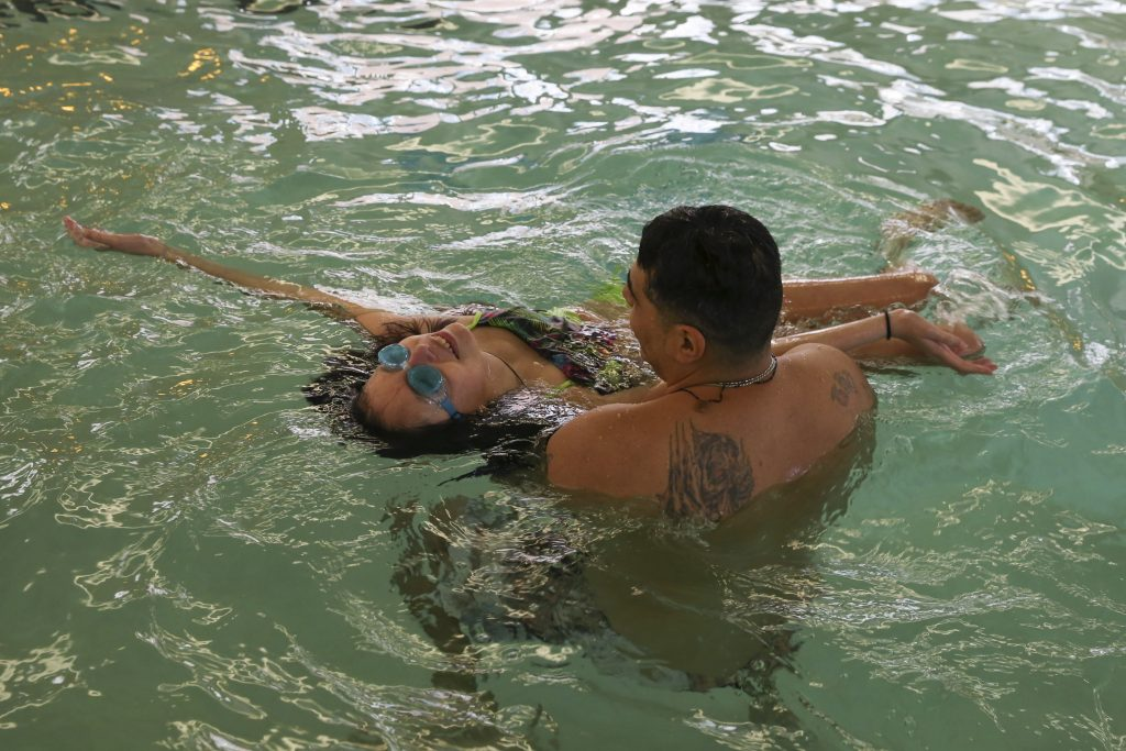Agustin teaches Lola how to float on her back at a hotel swimming pool on April 9, 2017. After four months of chemo, Lola met her breaking point and ended the trial, a decision based on her quality of life. Revitalized, Lola gained the energy to become active in enjoying her favorite activities that the grueling nature of side effects had previously restricted.